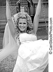 Playful Bride - A playful bride on a swing at the park