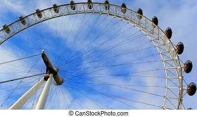 The London Eye ferris wheel. blue sky and white clouds.