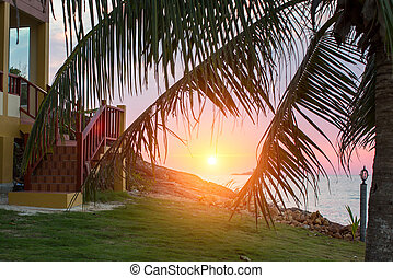 Porch of the house and beautiful sunset on the tropical...