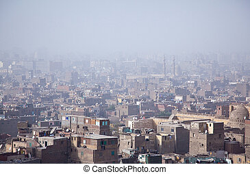 View over smoggy slums of Cairo - View into a misty city of...