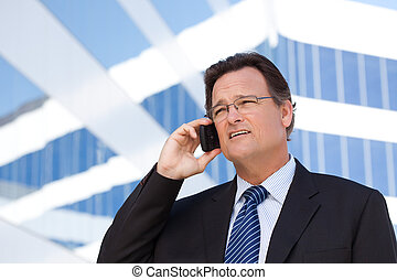 Businessman Smiles as He Talks on His Cell Phone