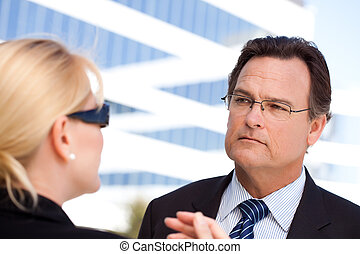 Businessman Listens to Female Colleague - Attentive Handsome...