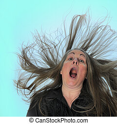 Woman Screaming - A woman screaming in front of a blue...
