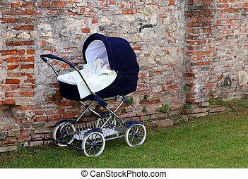 pram for newborn babies on the garden and the wall - classic...