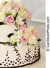Tiered wedding cake - details of beautiful tiered wedding...
