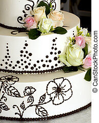 Tiered wedding cake - closeup details of beautiful tiered...