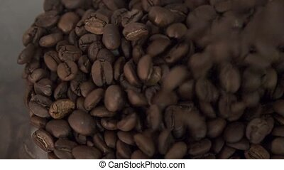 Coffee beans in the roasting machine. Selective focus. Copy space