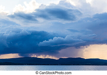 dark strom cloud over mountain Maskinongé Lake,...