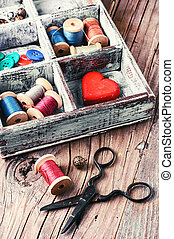 box with sewing tools - Wooden box with reels of sewing...