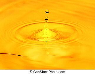 A drop of golden water. macro