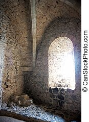 Arched Window Inside a Castle - A medieval arched stone...