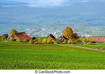 Green meadows above Lake Lucerne, near mount Rigi, Alps,...