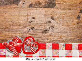 Valentines day background with handmade toy hearts over wooden table