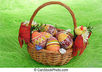 Easter Eggs - Easter eggs in basket on green Grass