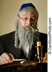 Torah pointer - Old jewish man with beard reading with a...