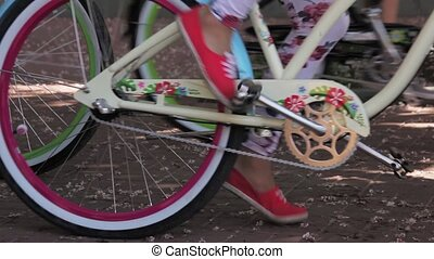 Many colorful bicycle start moving in diferent directions in...