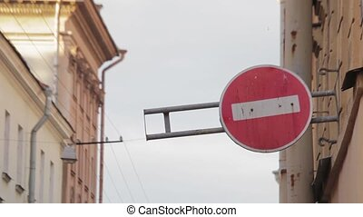 Round road sign, which forbids drive in it's direction in...
