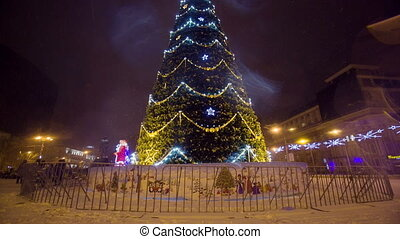 Christmass tree with garland at evening city - Christmass...