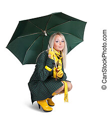 girl in green coat with umbrella - Blonde girl in green coat...