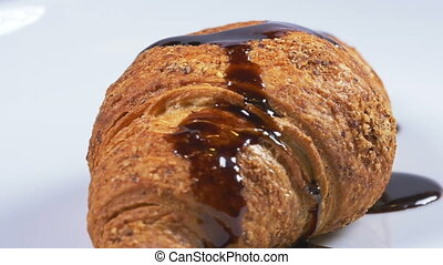 Chocolate covering a croissant - Delicious melted chocolate...