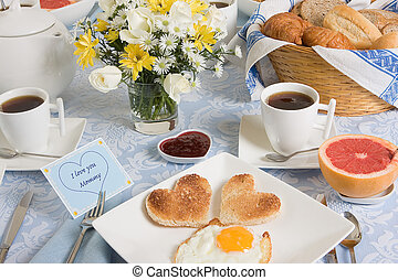 Eggs and hearts - Mothers day breakfast table with eggs and...