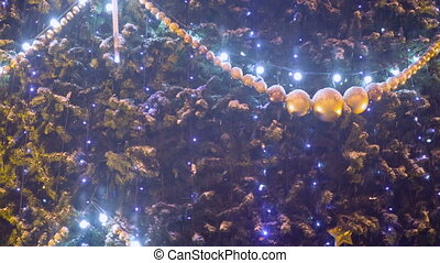 Decoration on Christmass tree at evening city - Christmass...