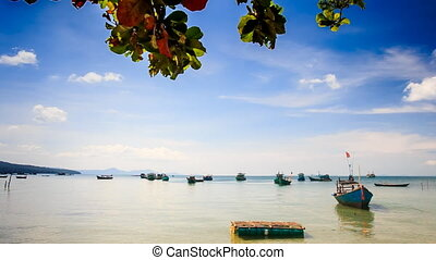Vietnamese Boats Rock in Shallow Bay against Boats on...