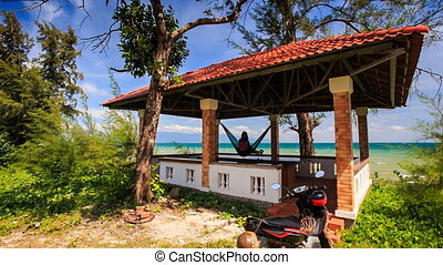 Red Roof Pavilion with Girl in Hammock is on High Beach -...