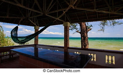 Panorama of Skyline through Pavilion under Roof with Hammock...