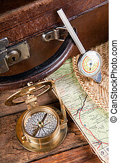 Old travelling items - Vintage suitcase, compass, map and...