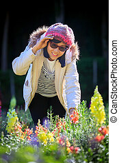 portrait of happiness asian woman with smiling face in blooming flowers garden use for relaxing people in vacation traveling