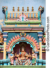Hindu Goddess statue on temple roof