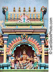 Hindu Goddess statue on temple roof