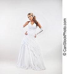 Full-length portrait of gorgeous bride wearing wedding dress...