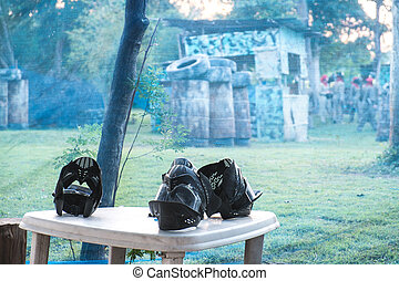 Leisure activity, paintball masks on table and paintball...