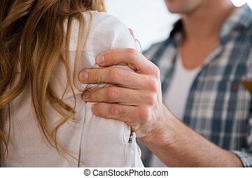 Agressive man hand grabbed woman shoulder - Closeup of...