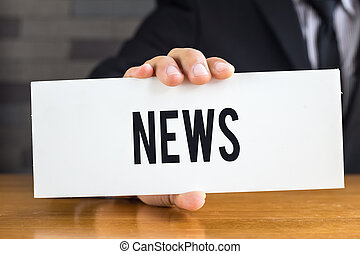 News, message on white card and hold by