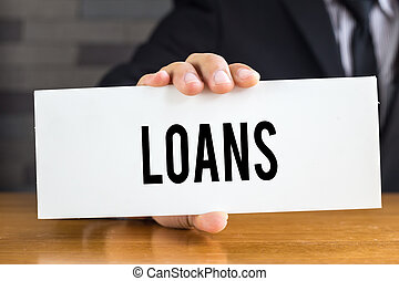 Loans, message on white card and hold by