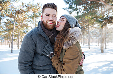 Woman showing tongue to her boyfriend