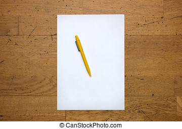 Pen on a blank white paper sheet