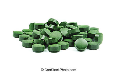 spirulina tablets isolated on white background