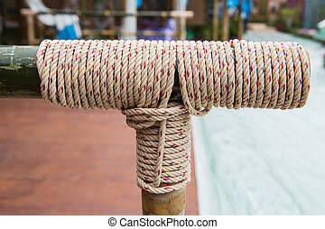 Rope tied knot at bamboo wood