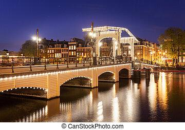 tilt shift image of skinny bridge in Amsterdam, the...