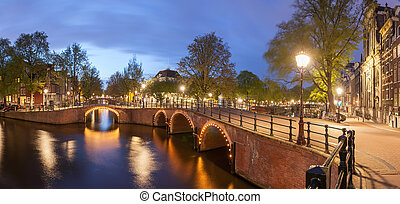 Panorama of beautifull Amsterdam canals with bridge and...