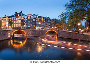 Beautifull Amsterdam canals with bridge and typical dutch...