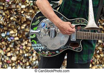 A street musician busker entertain public on Pont des Arts...