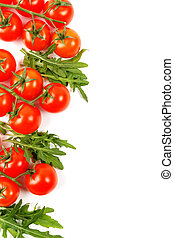 branches of small tomatoes with arugula on a white background