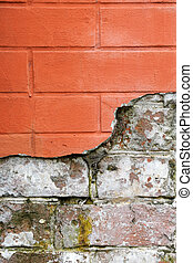 red broken brick wall close up