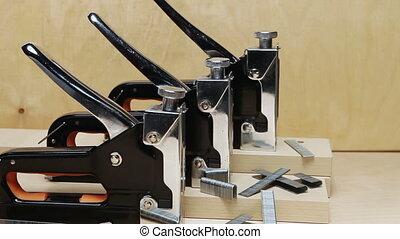 The tool - stapler manual mechanical - for repair work in...