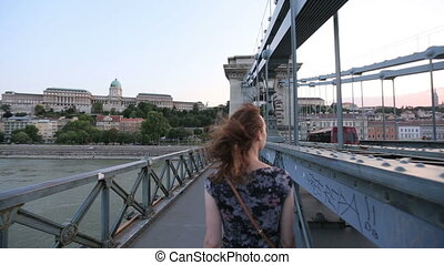 A girl walking on the bridge